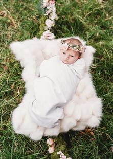newborn photo with flowers