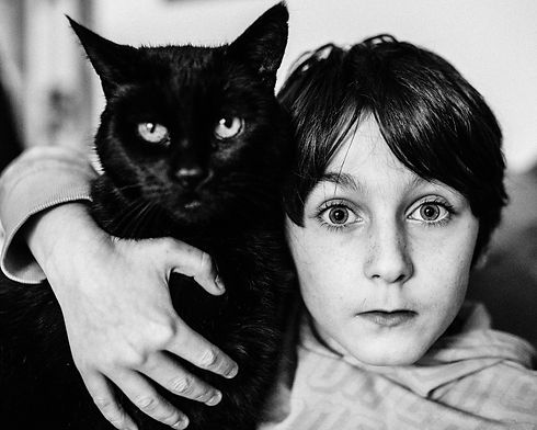 portrait of a boy and his cat
