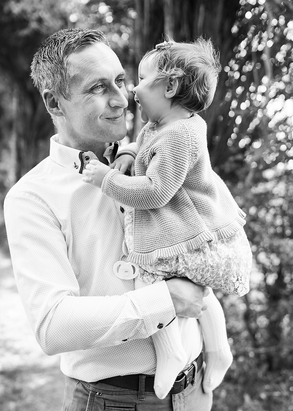 baby whispering in her dads ear. Father and daughter photoshoot, cavan