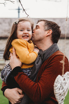 father kisses his daughter