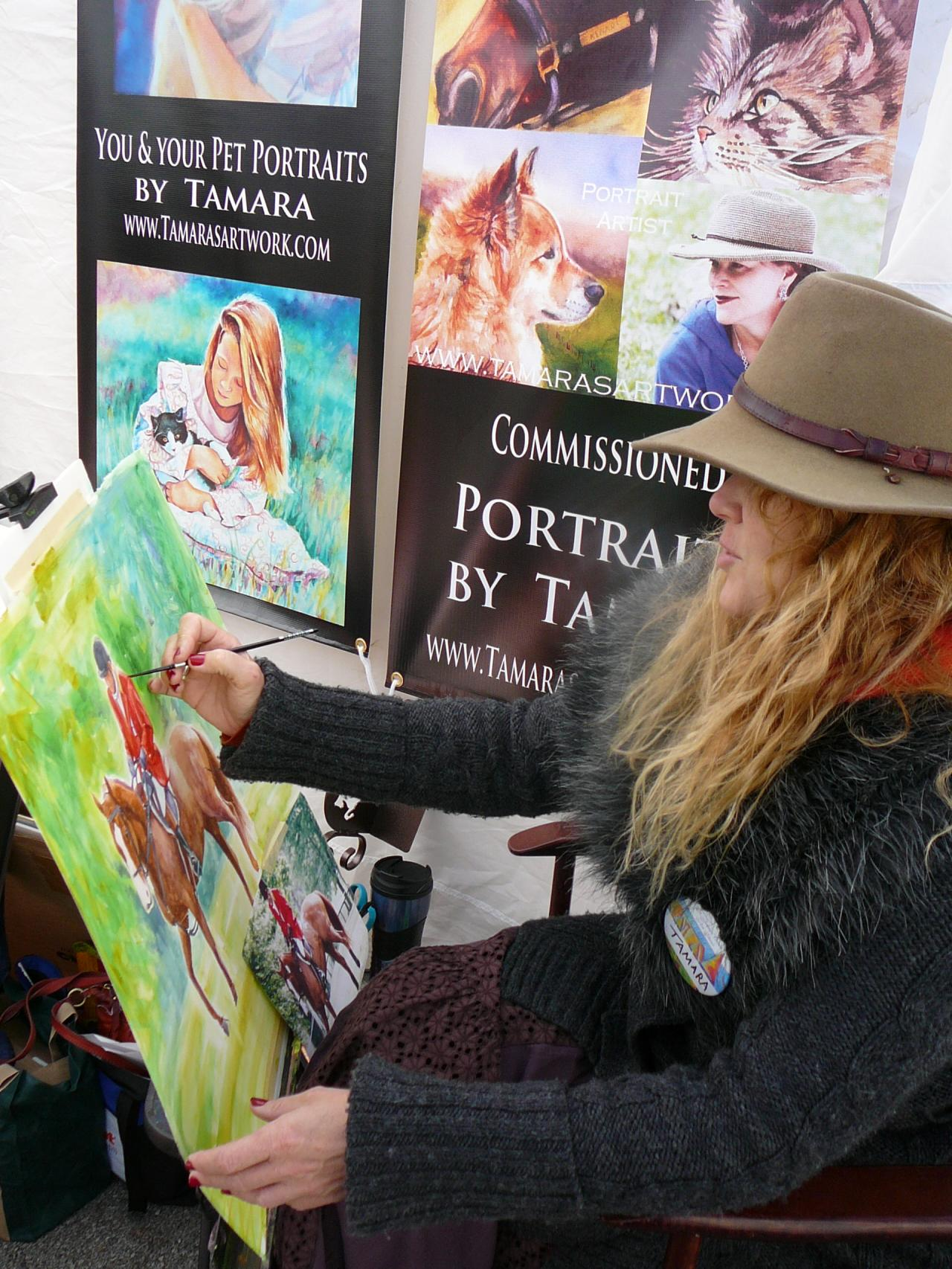 Tamara Painting in her booth