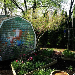 Painted back of gardening shed