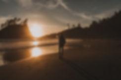 silhouette-of-person-walking-on-beach-du