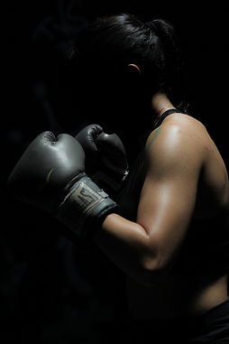 photo-of-woman-in-boxing-gloves-1608099.