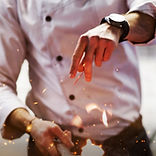 man cooking flames.jpg