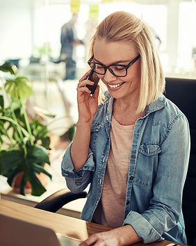 smiling-businesswoman-sitting-in-an-offi