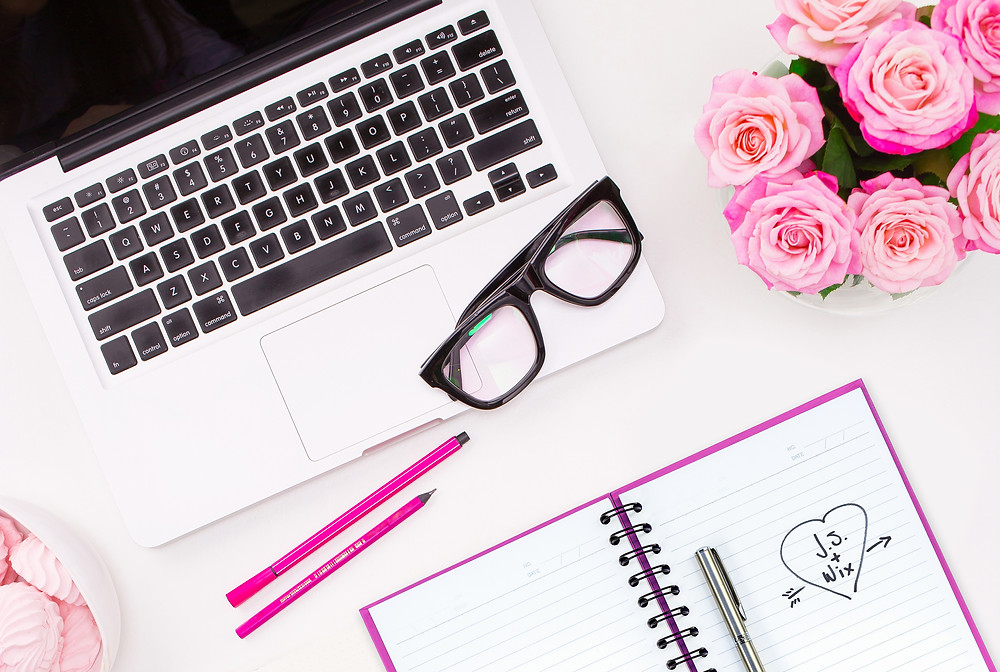 Laptop with Flowers and Pink Notebook