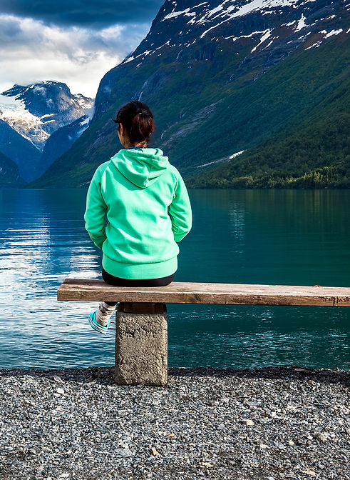 Woman on Bench by mountains