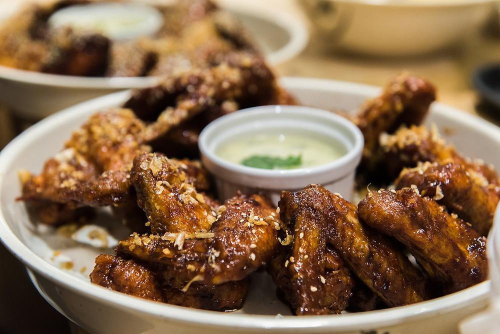 Black vinegar fried wings with Colston Bassett Stilton dipping sauce