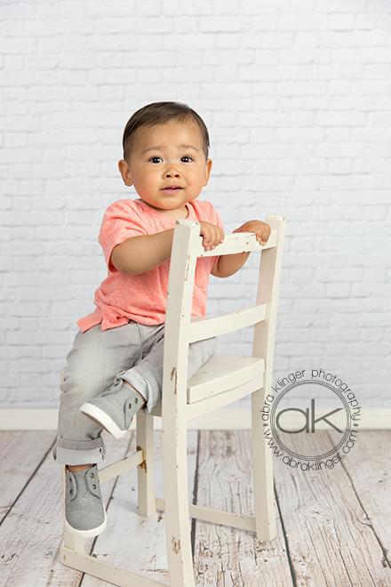 Boy on white child's chair