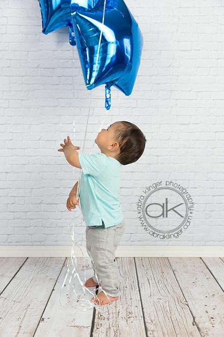 Birthday boy with blue balloons