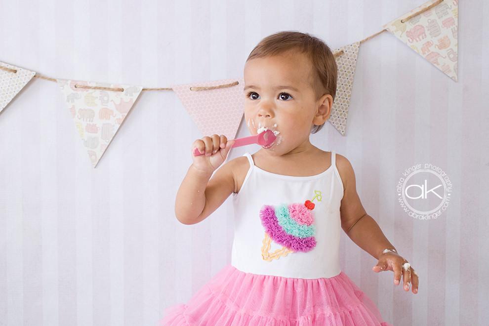 1 year old eating cake