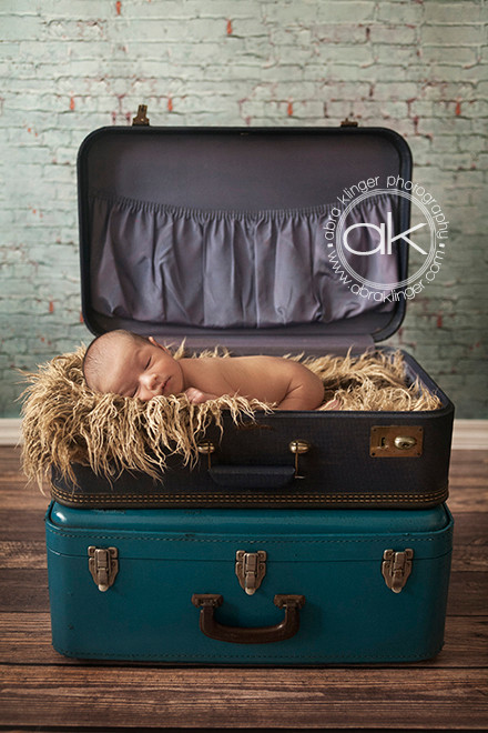 Baby boy in blue suitcase