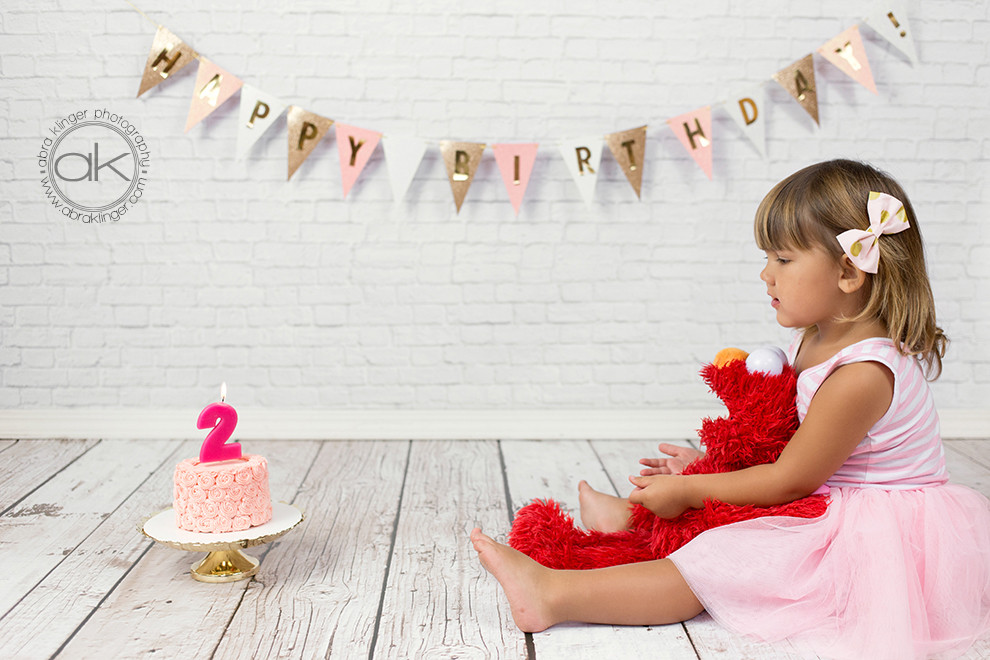 2 year old with birthday cake