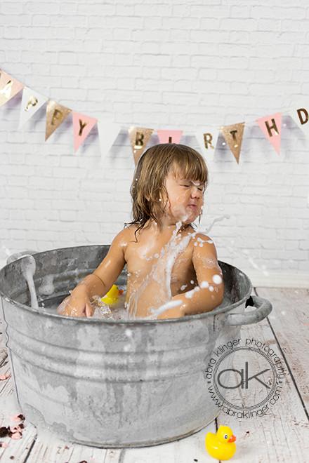 Girl splashing in tub