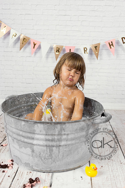 Girl splashing in tin tub