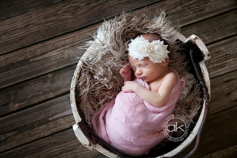 baby girl in bucket