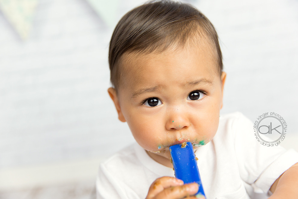 Boy with bottom of candle in his mouth