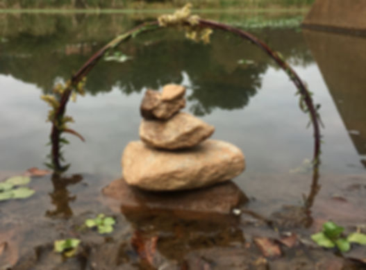 This piece was created using things found in nature. We used vines, weeds, and rocks to create the illusion of unity and balance.