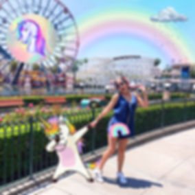 Girl and unicorn at a theme park