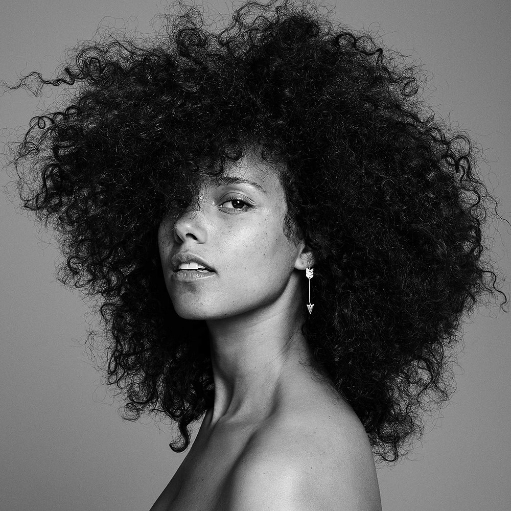 "Alicia Keys. Her album ""Here"" is now available."