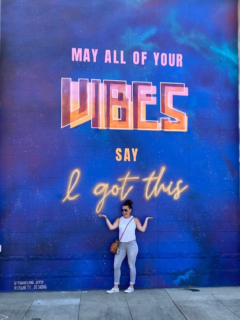 """Me in front of a gorgeous mural at the Metropolitan in Charlotte, NC. It reads: """"May all your vibes say I got this."""" Photo cred my BFF and editor, RBF."""