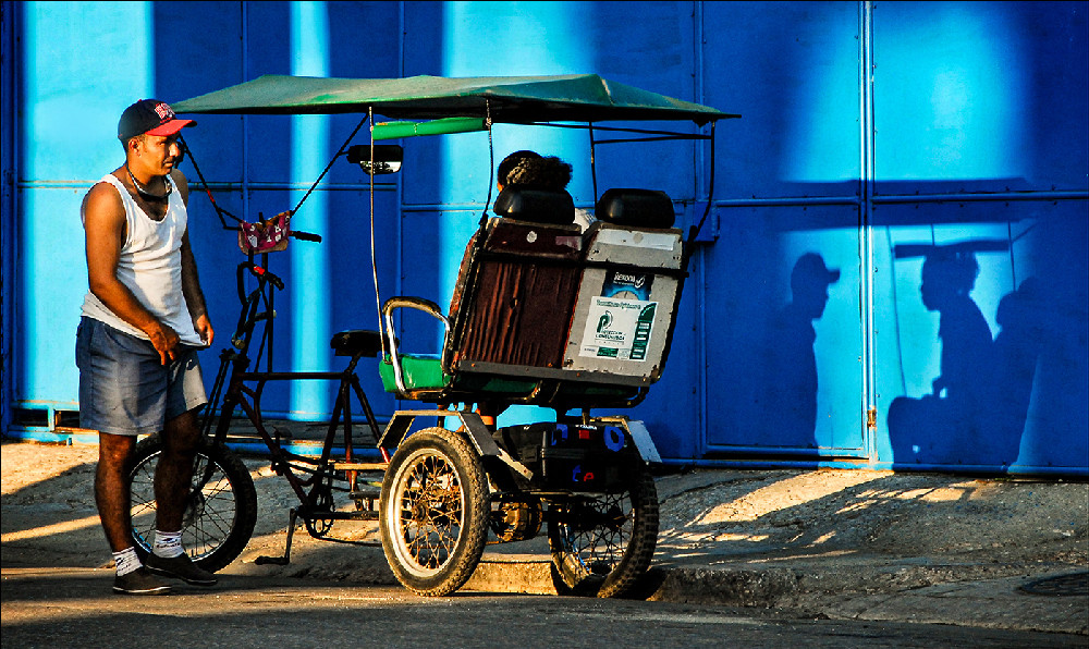 Bicycle taxi and shadow