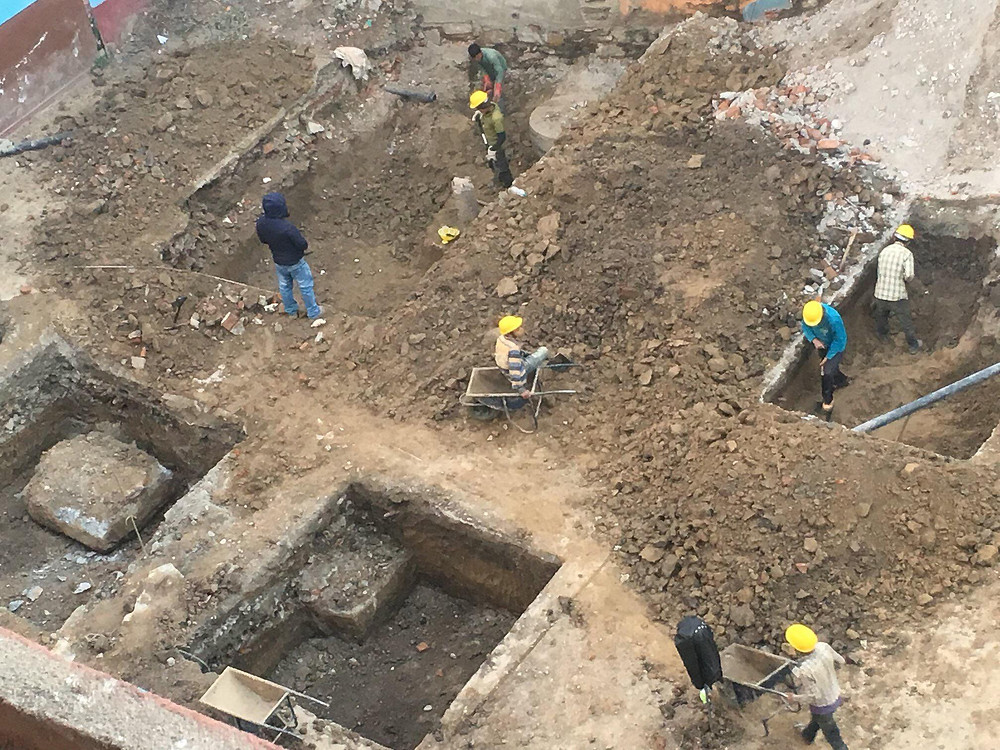 Workers lay the solid foundations for the new building