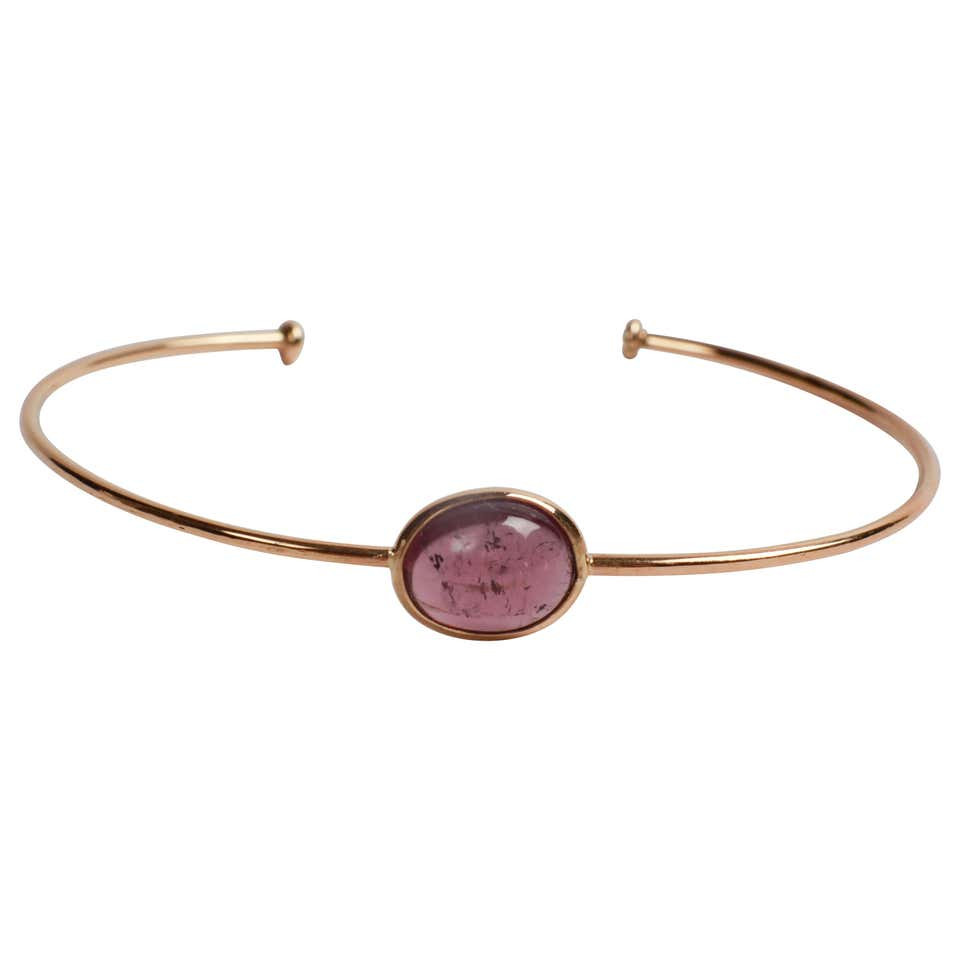Yellow Gold Bangle Set with a Purple Tourmaline Created by Marion Jeantet