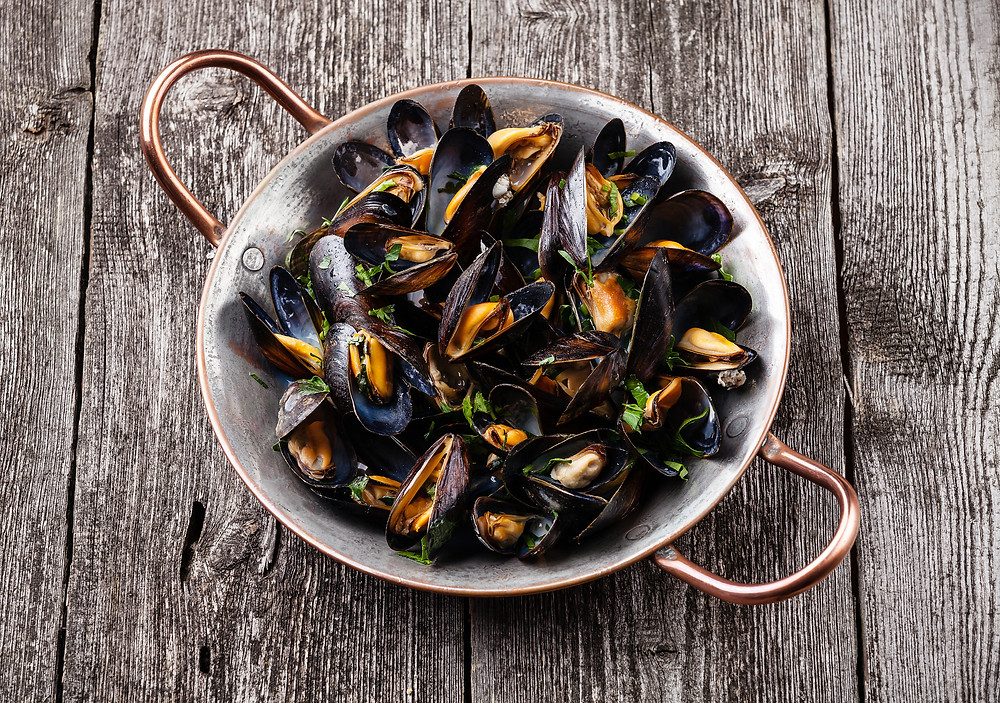 Boiled Mussels In Copper Cooking Dish On Dark Wooden Background.jpg