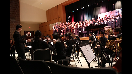 Louis A. Josephson conducting the combined Choirs and Orchestra of WW-P High School South.