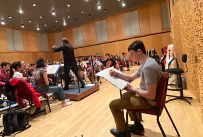 "Rehearsing ""Hyperactivity"" with the Juilliard Pre-College Symphony for the premiere. (November 2019)"