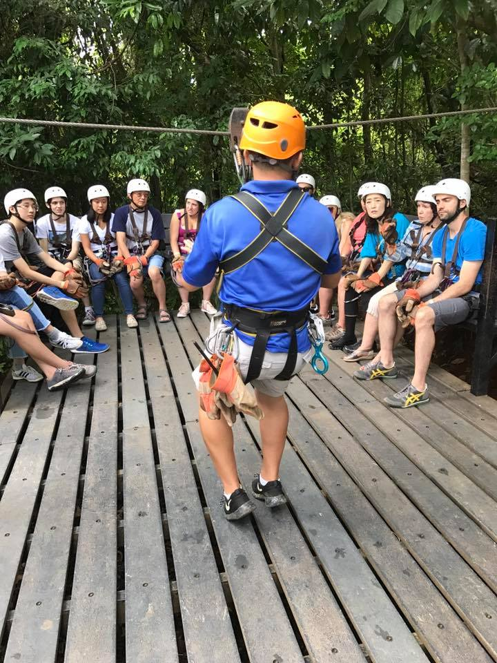 zip-lining group photo