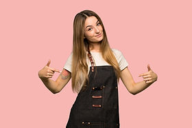 Young woman with apron proud and self-sa