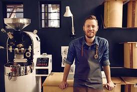 Entrepreneur in his modern coffee roastr
