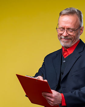 Middle aged businessman holding file fol