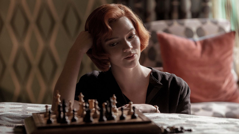 Female chess player looks at board. A still from the Netflix Original The Queen's Gambit