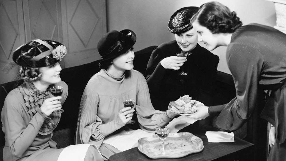 Irish women enjoying tea and cake to celebrate Nollaig na mBan or Little Chrtismas.