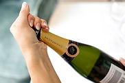 NLF - kurk van champagnefles draaien.jpg