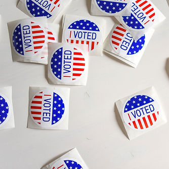 Voted%20printed%20papers%20on%20white%20