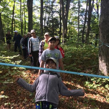 Students playing a limbo