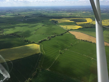 Flying over the countryside in spring