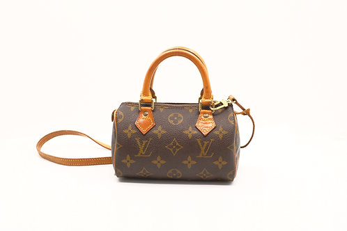 Louis Vuitton Mini Speedy with a Strap in Monogram Canvas
