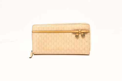 Gucci Guccissima Zipped long wallet in Varnished Leather