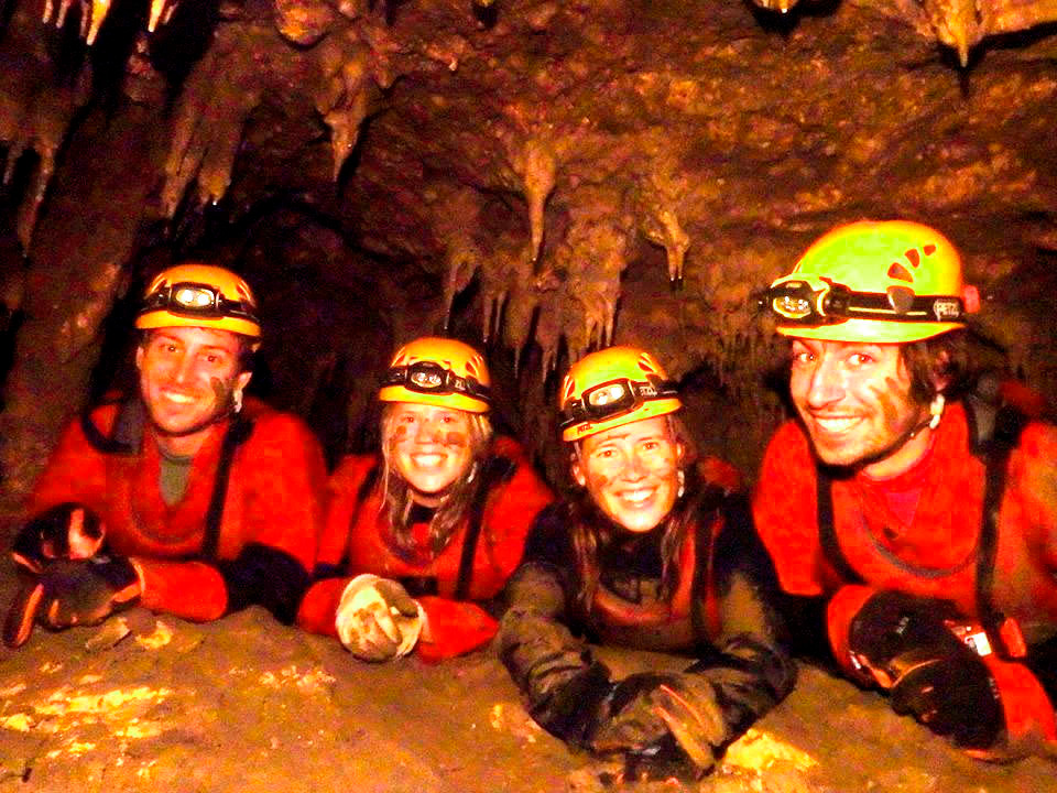 These foreigners are all smile even if he just crawled a muddy area inside the Lobo Cave in Jiabong, Samar. (Photo courtesy of Joni Bonifacio)