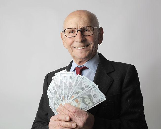 man-in-black-suit-holding-dollar-bills-3