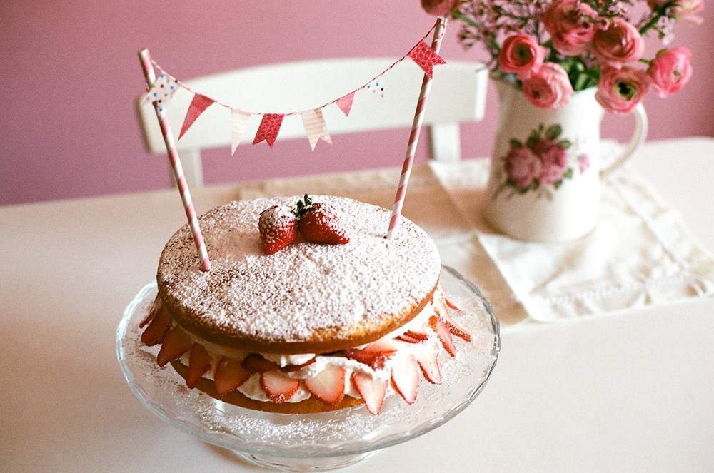 A freshly baked strawberry sandwich cake