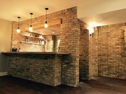 beautiful brick bar and kitchen