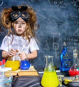 Funny little girl doing experiments in the laboratory. Explosion in the laboratory. Scienc
