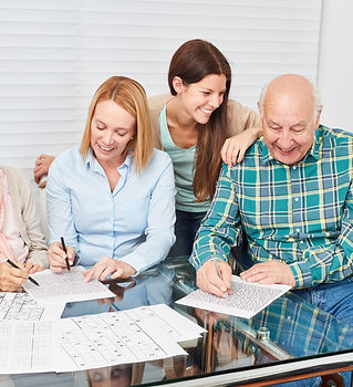 Family with seniors solve puzzles as memory training against dementia.jpg